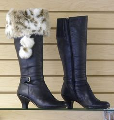Why buy fur-topped boots when you can wear Top of the Boot faux fur boot toppers with the boots you already own!  A lot less expensive and a lot more versatile.  www.mytopoftheboot.com