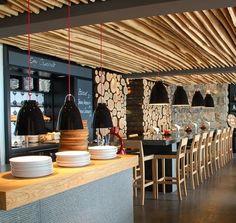 Cool rustic interior of a contemporary restaurant in Switzerland.