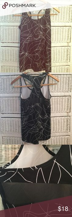 Brand New Fabletics Tank Never worn, with tags. Racerback with mesh exposure slip. Breathable, anti-sweat fabric perfect for tough workouts. Fabletics Tops Tank Tops