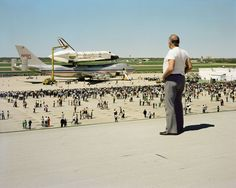 stranger passing The Space Shuttle Columbia Lands at Kelly Lackland Air Force Base, San Antonio, Texas, March 1979 by joel sternfeld
