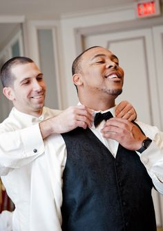 Let them help with the bow tie.   18 Glorious Ideas For Groomsmen Photos