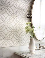 Claudette, a stone waterjet mosaic, shown in polished Afyon White and polished…