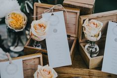 seating chart with wooden boxes and flowers