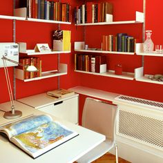 Vitsoe shelves, red paint is Firefly by The Little Green Paint Company