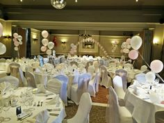 The Manor Hotel, baby pink sashes, satin top table swag and balloon arch.