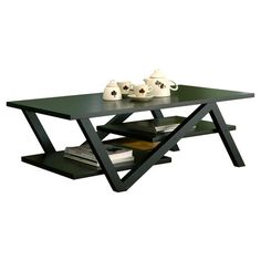 Perfect topped with glossy art books or a cluster of potted succulents, this striking coffee table features an angular design and 2 lower shelves.