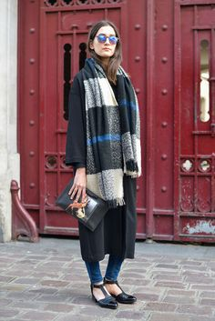 Take your daily uniform up a notch like this PFW attendee by simply throwing on a plaid blanket—there are endless ways to style it.   - MarieClaire.com
