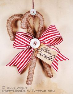 Twine wrapped candy canes with a bow!