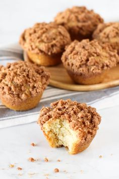Gluten Free Vegan Coffee Cake Muffins. Fluffy vanilla muffins with a cinnamon crumb topping. Perfectly paired with a cup of coffee or tea! #recipe #glutenfree  #healthyliving #cakerecipe #muffins