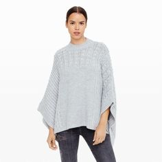 """Follow autumn's textural knitwear narrative with our Janeen—a chunky-knit poncho crafted in a supple acrylic blend with alpaca and merino wool. Acrylic/alpaca/wool Oversized fit 24"""" in length from high point of shoulder Round neck; allover variegated knit; wide poncho-style sleeves Hand wash Imported"""