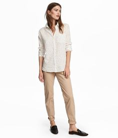 Check this out! Chinos in airy, woven cotton fabric. Hook-and-eye fastener, zip fly, side pockets, and welt back pockets with button. Tapered legs. - Visit hm.com to see more.