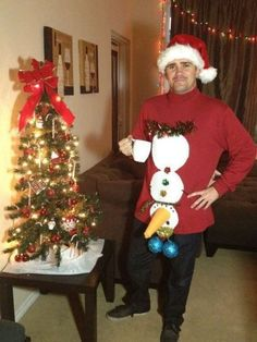 Tacky Christmas holiday sweater party - love the blue balls and snowman