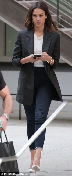 Dressed to impress: The actress sported an oversized blazer on top of a T-shirt, skinny jeans and heels