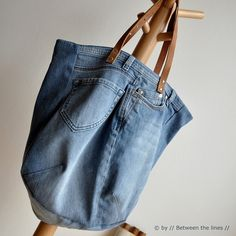 Cute demin purse made from old jeans with leather straps.