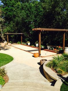 Bocce court with string lights ....wood, metal arbors made to age , metal brackets .