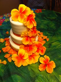 Hawaiian Wedding Cake - White cake with Cream Cheese icing.  Rum flavored fondant with gumpaste Hibiscus flowers airbrushed with food color.