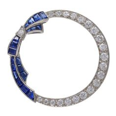 Antique Sapphire Diamond Platinum Circle Bow Pin   From a unique collection of vintage brooches at https://www.1stdibs.com/jewelry/brooches/brooches/