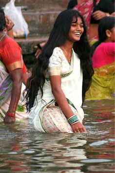 A dip in the Ganges fully clothed