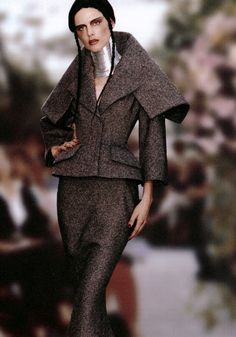 John Galliano for Dior, 1990s with Burmese neck brace and New Look silhouette. He was the head designer at Dior from 1996 to 2011 until he was told to leave for his anti-semitic remarks.