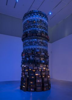 Music in art | A circular tower made from hundreds of old radios which the artist has stacked in layers, creates a cacophony of sound. The artwork's title 'Babel' refers to a biblical story. The radios in Meireles' tower are tuned to lots of different stations so they compete with each other and create a cacophony of low, continuous sound, resulting in inaccessible music, voices and information.