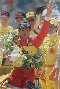 Rick Mears holds up three fingers to signify his third Indianapolis 500 victory after the 1988 race. In all Mears won four times: 1979, '84, '88 & '91.