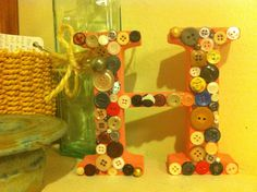 Letter decorated with buttons.