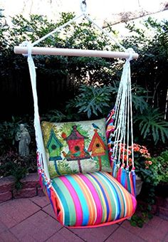 Hammock Swing Chair Multi Colored Stripe with Birdhouses Pillow. Fabrics are 100% polyester but feel like natural cotton and can be used outdoors or indoors. They are very comfortable - get a book and relax the day away.