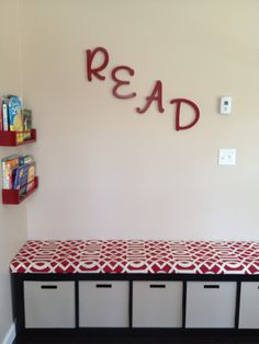 This is the kids new reading area! The bins are HUGE and hold so many toys!!