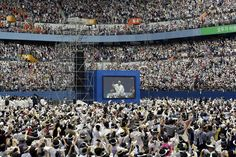 Pope Francis is seen on a giant screen after arriving for the Holy Mass at Daejeon World Cup stadium in South Korea, August 15, 2014. REUTERS/Lee Jin-man/Pool