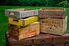 Wooden Crates    Collection of wooden box/crates. Can be used upside-down or turned sideways for displaying ceremony programs, favors, gifts, etc. Can also be used to hold flip-flops, wraps, umbrellas or other favors. Can be rented as a group or individually. (from Stonegate Rentals, VA)