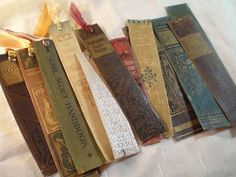 "Bookmarks made out of old book spines.  I wish I would have saved some of those ""ruined"" books!!"