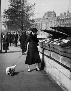 ANDRÉ KERTÉSZ. Dog Walker, Book Vendors, Paris, 1927