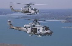 USMC UH-1Y & AH-1Z. Enter the H-1 program, the USMC's plan to remanufacture older helicopters into new and improved UH-1Y utility and AH-1Z attack helicopters. The new versions would discard the signature 2-bladed rotors for modern 4-bladed improvements, redo the aircraft's electronics, and add improved engines and weapons to offer a new level of performance. It seemed simple, but hasn't quite worked out that way. The H-1 program has encountered its share of delays and issues, but the…