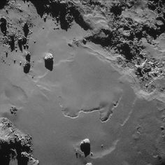Incredible New Photos Taken From the Surface of a Comet | Image of the comet taken by Rosetta from 10 kilometers away.   ESA/Rosetta/NAVCAM, CC BY-SA 3.0 IGO  | WIRED.com
