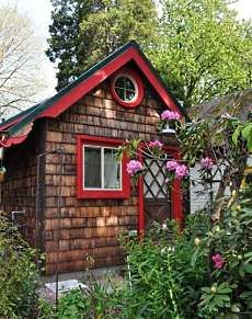 cottage design this is in Portland, Oregon I wouldn't have to move very far, the red trim is cute and I love little round windows