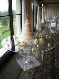 not like this but the clear cake table but with glass raised and petals underneath