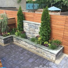 Get in touch with nature in the comfort of your backyard. Click the picture to learn more about what Cambridge Pavers can do for your outdoor living space! Photo: All Boro Masoon Supply