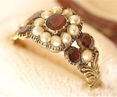 garnets and pearls.my absolute favorite combination, my dream ring! Jewelry Box, Jewelry Rings, Jewlery, Fine Jewelry, Art Nouveau, Vintage Magazine, Pearl Love, My Birthstone, Harry Winston