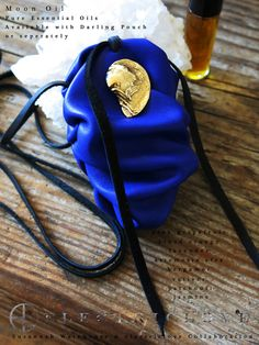 Our Moon Oil Scent with the Darling Pouch in Yves Blue and Brass Detail by Suzannah Wainhouse