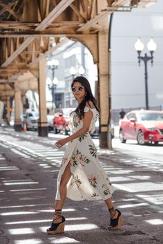 A flirty floral ruffled dress with wedges and rad sunglasses.