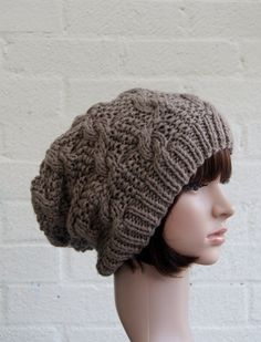 Chunky knit cable beanie in Walnut. Made from 100% vegan acrylic this slouchy beanie is warm and can be worn by both sexes. For other colour
