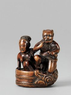 An Edo school boxwood netsuke of Raiden and young woman, by Hômin. Mid 19th century  The coy god of thunder with a drum tied to his back steps out from a shallow wash tub while a young woman, a towel slung over her shoulder, places her hand on his back. To the base billowing clouds rising behind Raiden. Signed Hômin in a rectangular reserve.