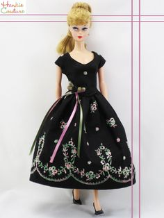 This Barbie dress is made from new embroidered fabric that I (Marsha of Hankie Couture) bought overseas in Italy! Jet-black cotton fabric has pretty machine embroidered flowers in pink and green, a sweet combo! Reproduction style has a working zipper, sold on Ebay in January 2015 by #Hankiecouture #doll #embroidery #Barbie