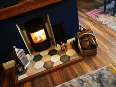 These geometric tiles from add playful style to this gorgeous fireplace. What a beautiful space it is, thank you for sharing and inspiring! Geometric Tiles, Hexagon Tiles, Mosaic Tiles, Wood Effect Tiles, Marble Effect, Luxury Vinyl Tile, Floor Colors, Tile Patterns