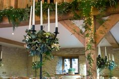 The Wilde Bunch black iron candelabra at Kingscote Barn. Handmade by a Dorset blacksmith to our unique design and perfect for Stone Barn weddings. Barn Wedding Flowers, Barn Wedding Venue, Barn Weddings, Kingscote Barn, Stone Barns, Candelabra, Blacksmithing, Countryside, Iron