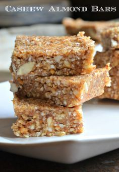 Raw cashews, almonds, coconut, almond butter and maple syrup make this gluten free dairy free and vegan snack irresistible !!