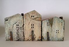set of 3 ceramic houses , made in high fired stoneware clay, painted with acrylic colors