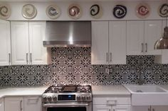 Kitchen. White grey kitchen decorating using black white flower patterned Moroccan tiles kitchen backsplash including white wood kitchen cabinet and colorful plate kitchen wall decors. Stunning images of Moroccan tiles kitchen backsplash