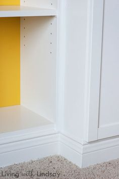 """How to Use a """"Built-In"""" Billy Bookcase to Hide an Eyesore via MakelyHome.com (Goulding - add molding to make look built-in)"""