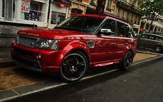 gotta love the candy apple red Range Rover Sport with black tint on those black rims